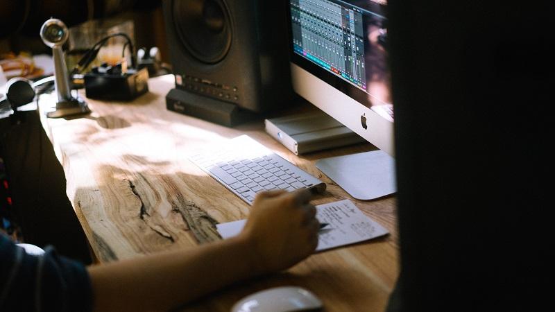 man in recording studio mac computer music