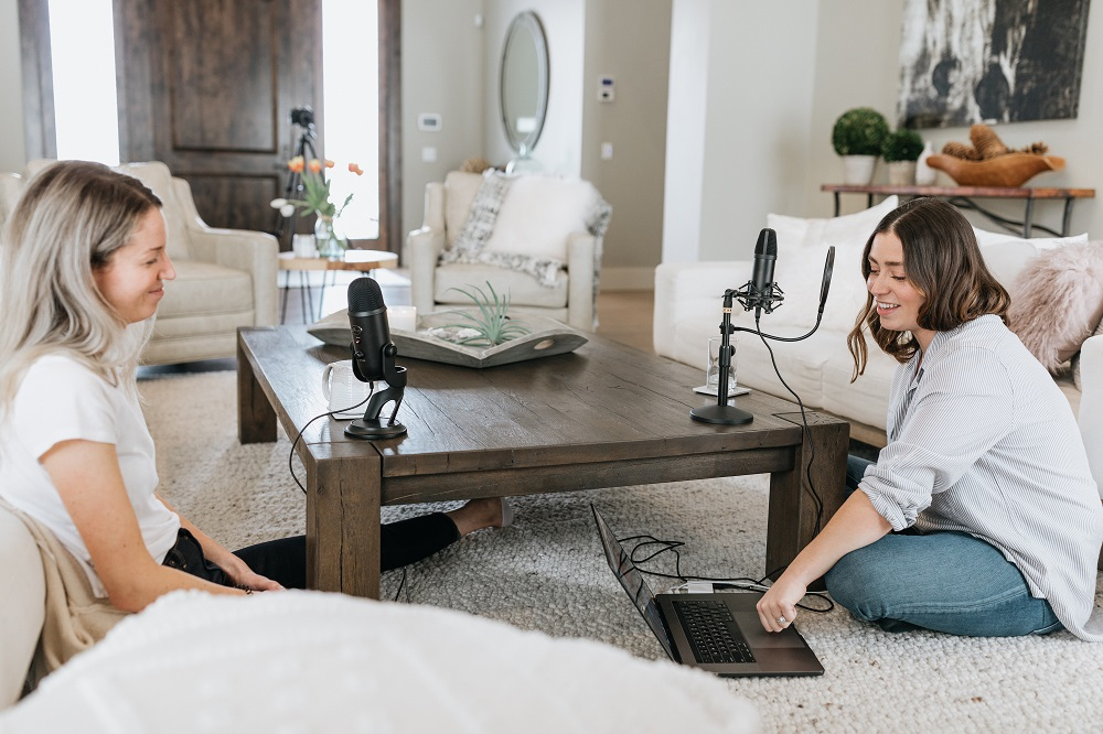 2 people recording a podcast